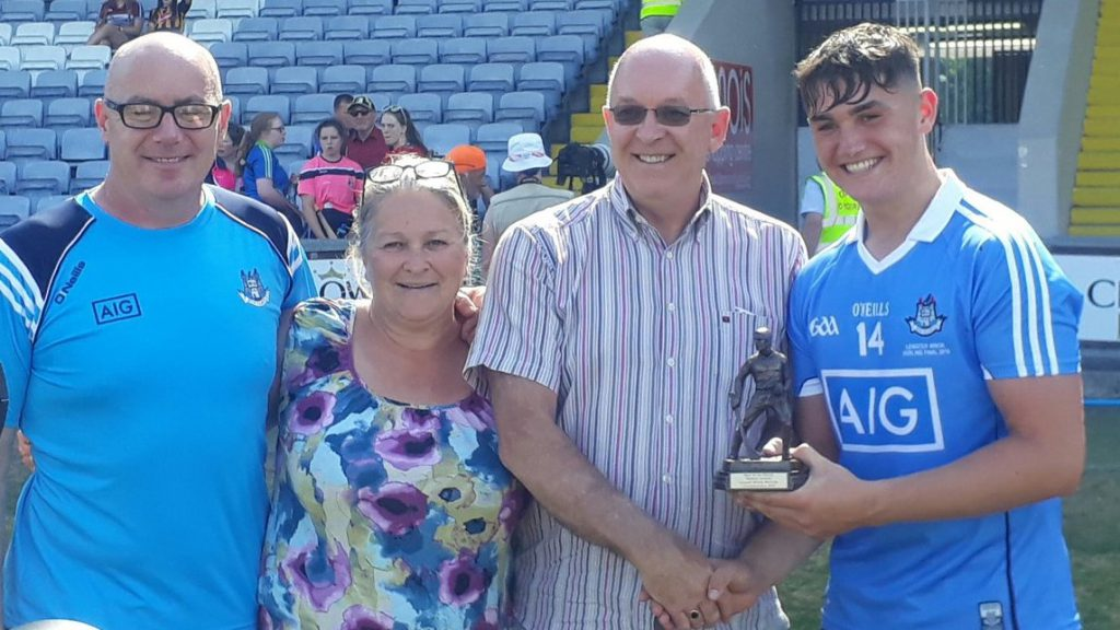 Man of the Match Luke Swan pictured with his parents and Paul Dempsey from sponsors, Electric Ireland